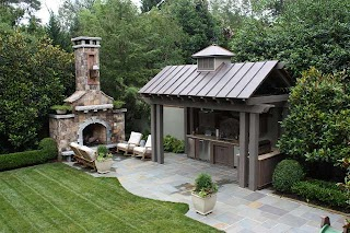 Outdoor Kitchens with Fireplace Kitchen and Traditional Patio Other By The