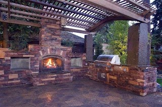 Outdoor Kitchen Fireplace and Pergola and Patio Cover Copper Creek