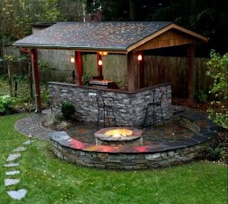 Outdoor Kitchen with Firepit Fire Pit Half Circle Wall Seating Photo