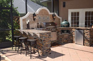 Outdoor Kitchen with Green Egg Big Gas Grill and Bar Seating