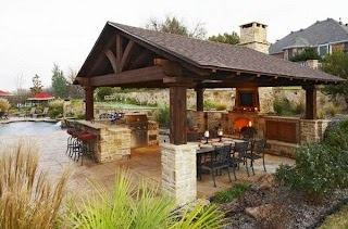Outdoor Covered Kitchen Designs Featuring Pizza Ovens Fireplaces and Other