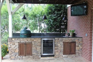Outdoor Kitchen with Big Green Egg Island and Fire Pit in Hoover Al