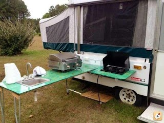Camper with Outdoor Kitchen Custom Camping Hacks
