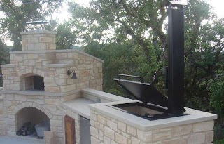 Outdoor Kitchen with Smoker Hill Country Features and Pizza Oven Patio