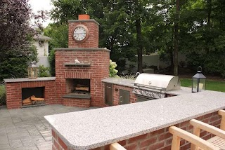 Brick Outdoor Kitchen Natural with Granite Countertop and Fireplace