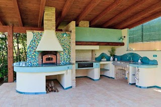 Italian Outdoor Kitchen with Mosaic Chimney Backsplash and Cucinare