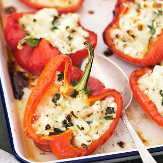 STUFFED RED PEPPERS WITH QUINOA, ZUCCHINI, AND FETA CHEESE.