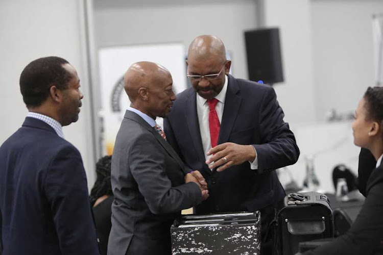 Adv Dali Mpofu (right) talks to former Sars commissioner Tom Moyane at the Commission into State Capture, in Parktown, Johannesburg. Moyane is applying for leave to cross-examine minister of public enterprises, Pravin Gordhan. 13 March 2019.