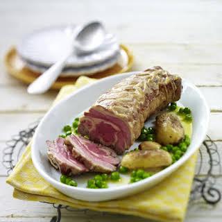 Roast Leg of Lamb with Bacon, Potatoes and Peas.