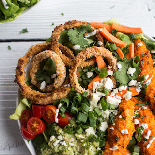 Buffalo Chicken and Crunchy Baked Onion Ring Salad with Blue Cheese.