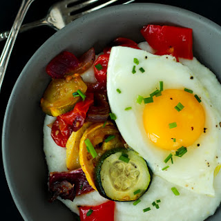 Creamy Goat Cheese Grits and Eggs with Roasted Vegetables.
