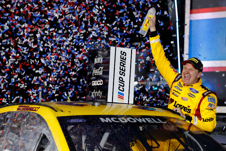 Michael McDowell, driver of the #34 Love's Travel Stops Ford, celebrates after winning the Nascar Cup Series 63rd Annual Daytona 500 at Daytona International Speedway on February 14 2021 in Daytona Beach, Florida.