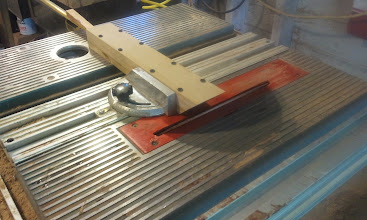 Photo: I made a jig to hold the half-oval brass strip while I ground the end to 45deg.