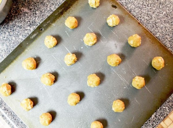 Carefully fashion small (think teaspoon sized) peanut butter balls and place about an inch...