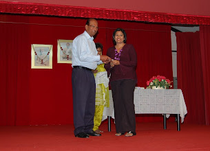 Photo: Mrs Uma receiving the Scholarship Award