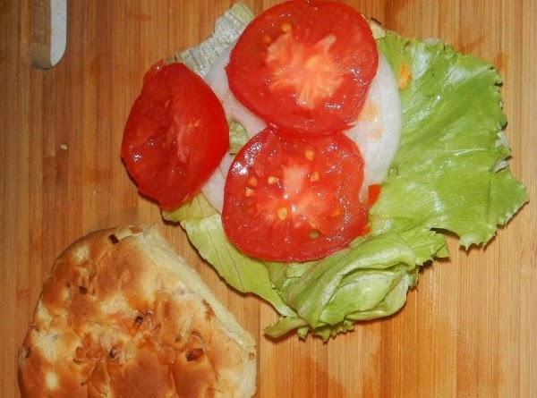 """Toast the bun. Have ready the """"makings"""" lettuce, slice of onion, and tomato slice/s."""