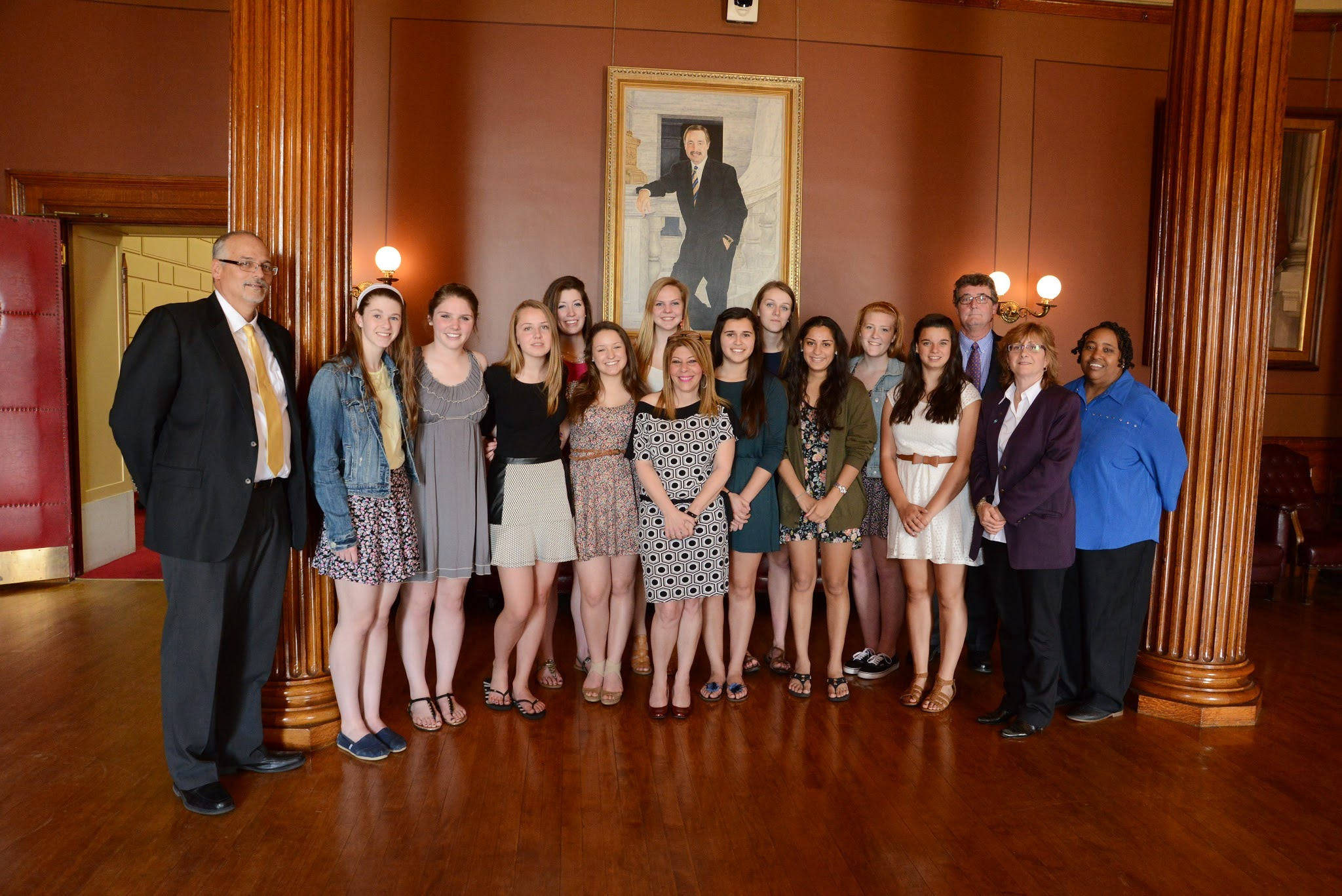 Photo: The North Kingstown High School girls' basketball team was honored by the House of Representatives on May 14, 2014, for winning the state Division I championship.  They were hosted by Reps. Doreen Costa, center; Robert Craven, in the back row at right, and Deb Ruggiero, second from right.