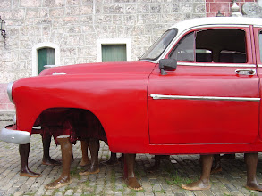 Photo: red car, art in cuba. Tracey Eaton photo.