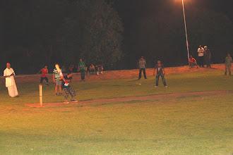 Photo: Madhyamik boys playing night cricket