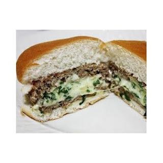 Spinach and Artichoke Stuffed Turkey Burgers.