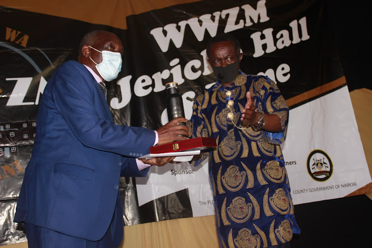 Lawyer PLO Lumumba, a trustee of Wasee wa Zamo hands James Muriuki his induction award at the Jericho Social Hall on March 6, 2020.