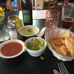 Chips and salsa. Don't let them fool you! The green salsa is spicy!