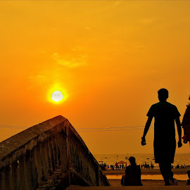 on the edge by Dharitri  Walia - People Street & Candids ( orange, beautiful, sunset, silhoutte, hue, evening, sun,  )