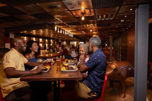 carnival-Pig-and-Anchor-family.jpg - Head to Guy's Pig and Anchor Bar-B-Que, featuring smoked beef, pork, andouille sausage and all the sides, during your Carnival cruise.
