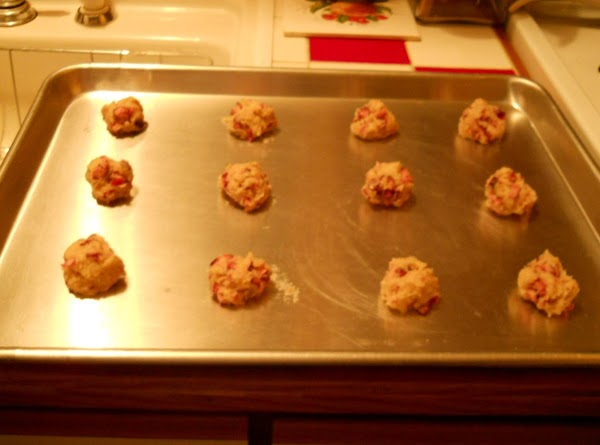 Drop dough by rounded tablespoonfuls onto ungreased cookie sheets, 2 inches apart.