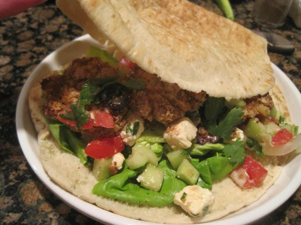 Line each of 4 pita breads with lettuce and place 3 falafels on top...