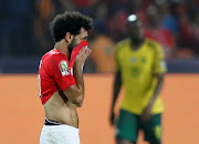Egypt's Mohamed Salah reacts after South Africa's Thembinkosi Lorch scored.