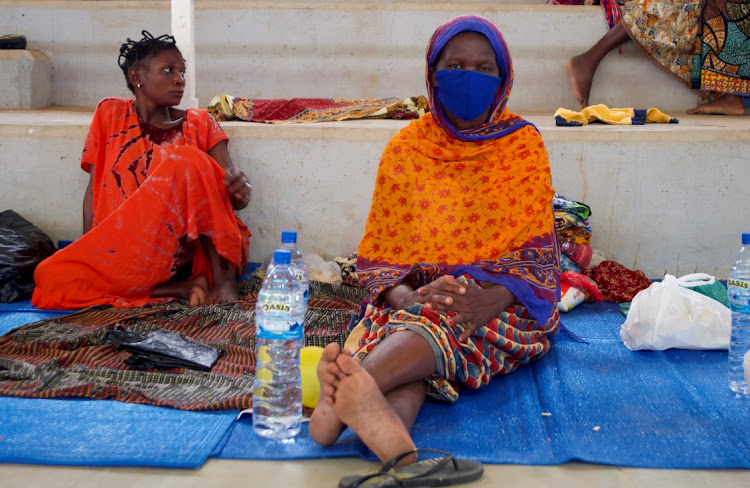 Displaced women sit on mats at a refugee centre in Pemba, Mozambique, April 2 2021. Picture: REUTERS/EMIDIO JOZINE