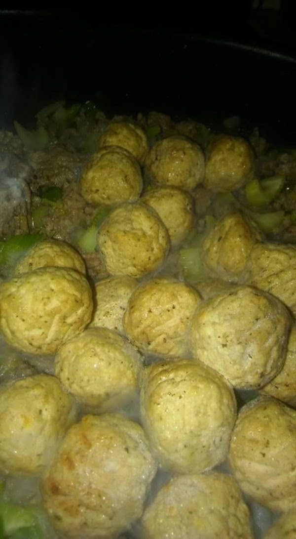 Add still frozen meatballs on top of other ingredients.  Cooking and stirring until...