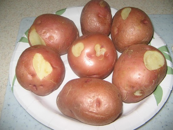 Wash potatoes and place on paper plate and microwave for 8-10 minutes (you can...