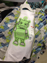 Photo: This robot shirt and Space Invaders hoodie in the baby section were so adorable!  I was tempted to get them for my nephew, but I had to remain focused on my mission.