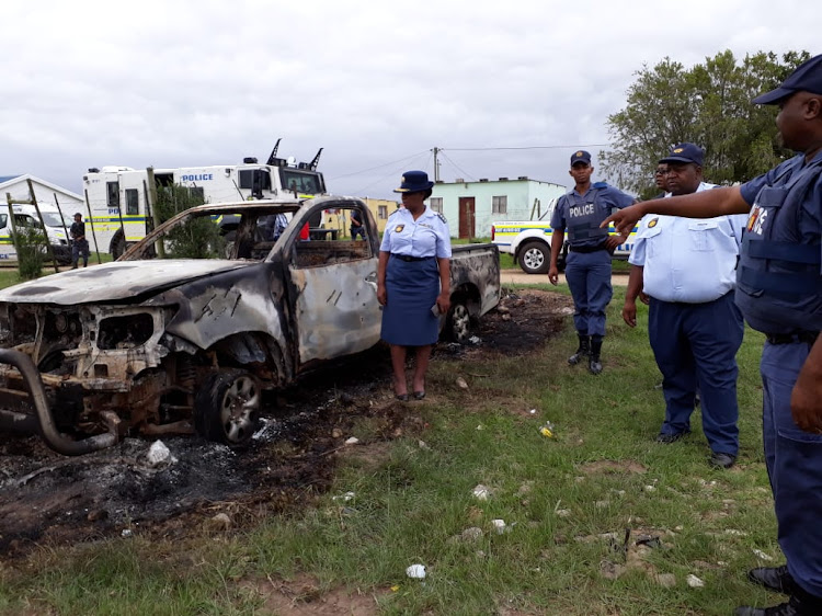 Provincial Commissioner Lieutenant-General Liziwe Ntshinga inspects one of the burnt out cars in Bathurst