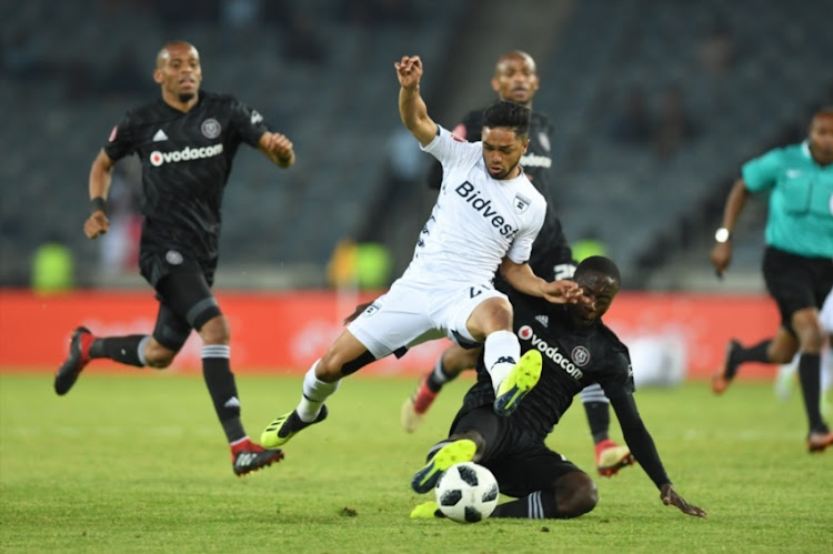 Haashim Domingo of Bidvest Wits and Ben Motshwari of Orlando Pirates during the Absa Premiership match between Orlando Pirates and Bidvest Wits at Orlando Stadium on August 15, 2018 in Johannesburg, South Africa.