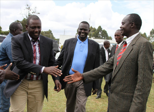 DP William Ruto and West Pokot Senator Samuel Poghisio in Eldoret.