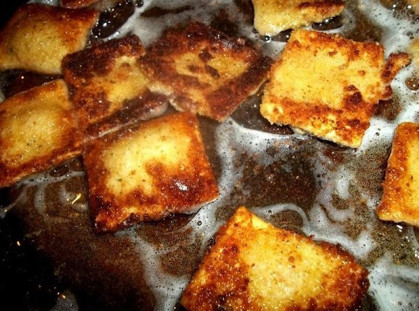 In a large skillet, heat about 1/2 cup oil. Once hot, add as many...