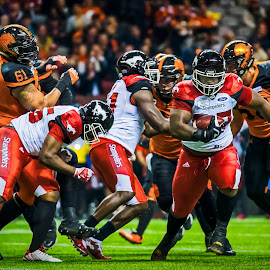 Midfield Breakaway by Garry Dosa - Sports & Fitness American and Canadian football ( sports, teams, players, cfl, black, football, lighting, people, orange, red, running, number, indoors, stadium, sport )