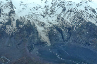 Photo: Aerial view of glacier snout (center) extending from the Myrdalsjokull ice cap.