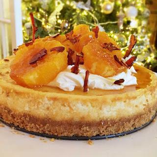 Festive Baked Orange Cheesecake with Caramelised Oranges and Mascarpone Icing.