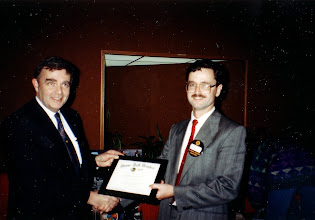 Photo: Research Chairman Neil Armstrong (left) presents a certificate to Nigel High of McKee Engineering