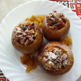 Baked Apples Stuffed With Walnuts, Raisins, And Dried Apricots.