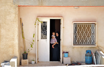 Photo: A woman and her child outside their home in Bethlehem, West Bank.