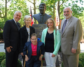 Photo: Eureka College President J. David Arnold (right) and Vice President for Development and Alumni Relations Mike Murtagh (left) and welcome Michele Sullivan of the Caterpillar Foundation with her goddaughter and mother. June 5, 2012.