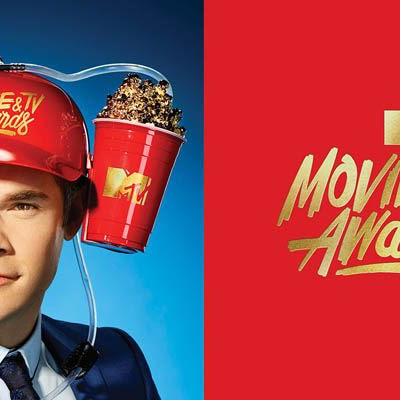 3d printing gallery image of a photoshoot still of adam devine wearing a 3d printed helmet with gold plated popcorn
