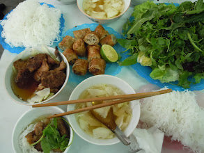 Photo: bun cha (grilled pork patties, pork served in fish sauce + nem and vegetables