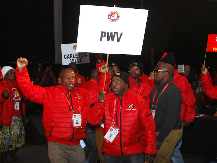 NUM members sing at the national congress in Boksburg. Picture: PUXLEY MAKGATHO