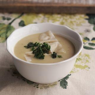 Truffle Potato Soup With Truffle Mushroom Dumplings And Fried Parsley.